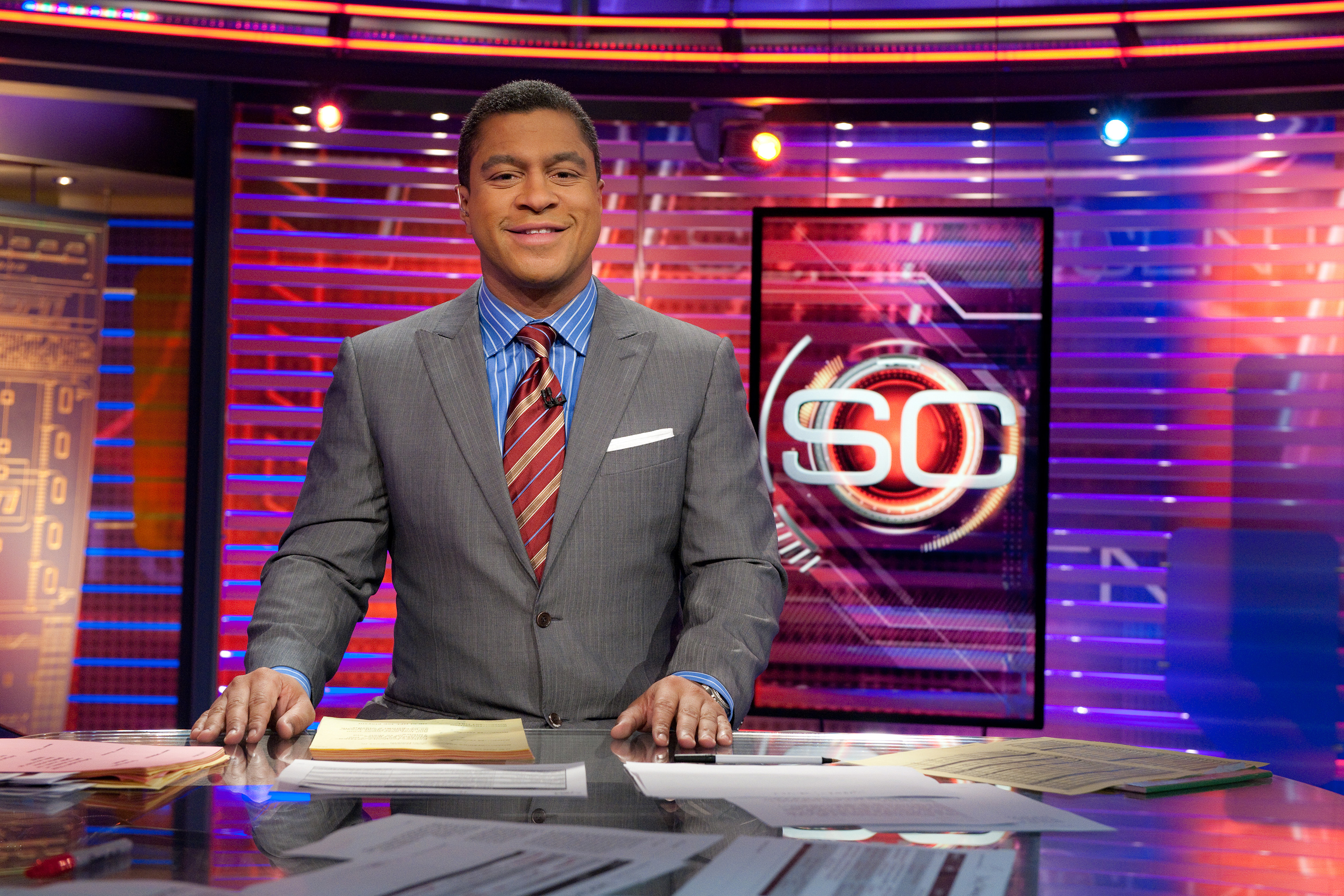 Stan on the set of Sportscenter smiling at the camera.
